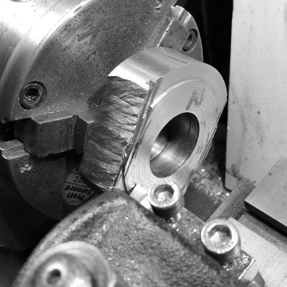 The rough billet is placed in the lathe, and an outer, larger diameter turned.