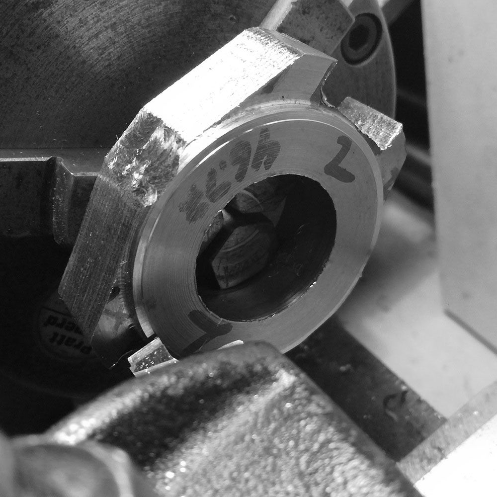 The case is placed on the lathe and the final diameter of the case turned as a reference point.
